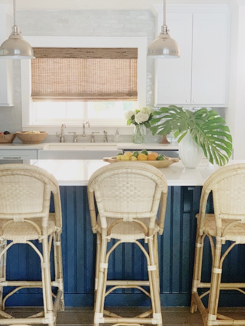 Blue kitchen island with Serena and lily counter stools